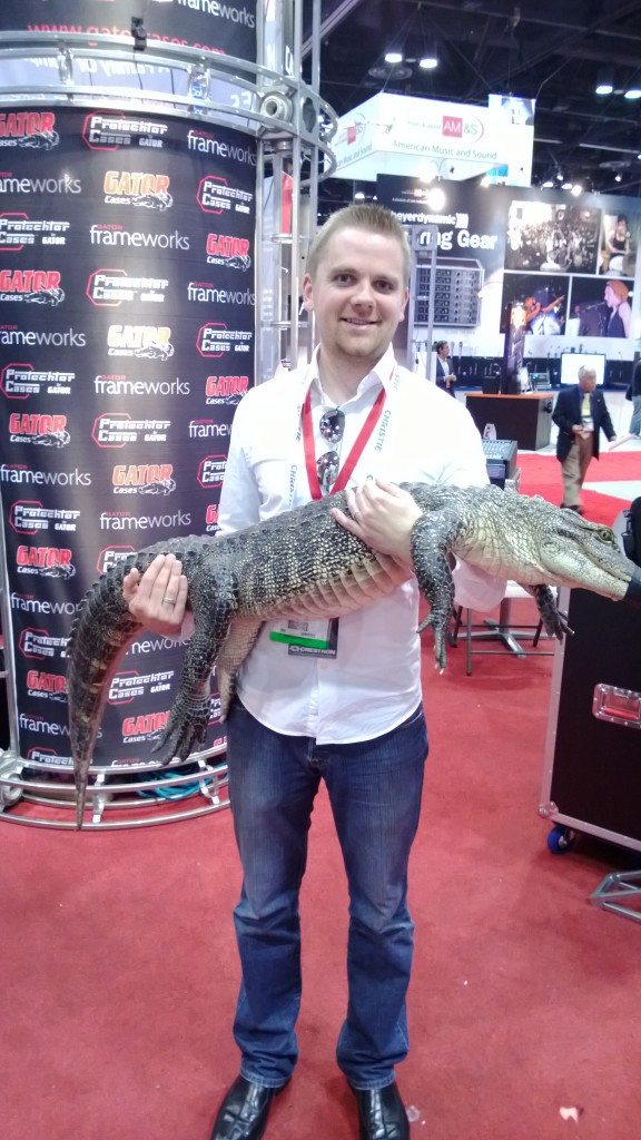 Held and alligator at the trade show. Why not?
