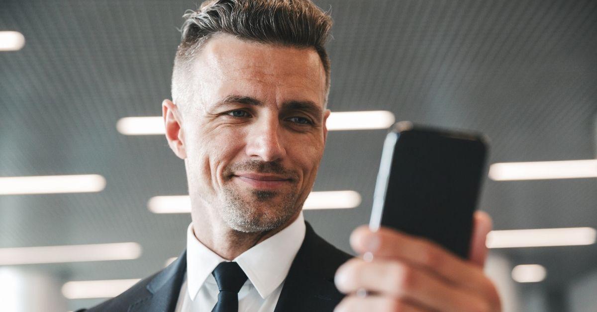 Guy looking at phone